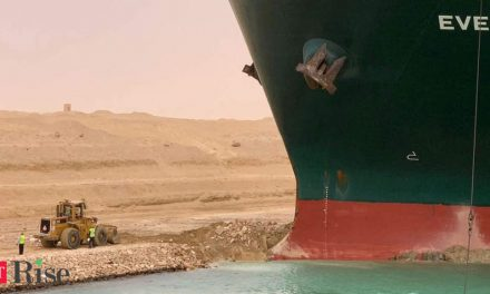 Tugs work to free ship stranded in Suez Canal